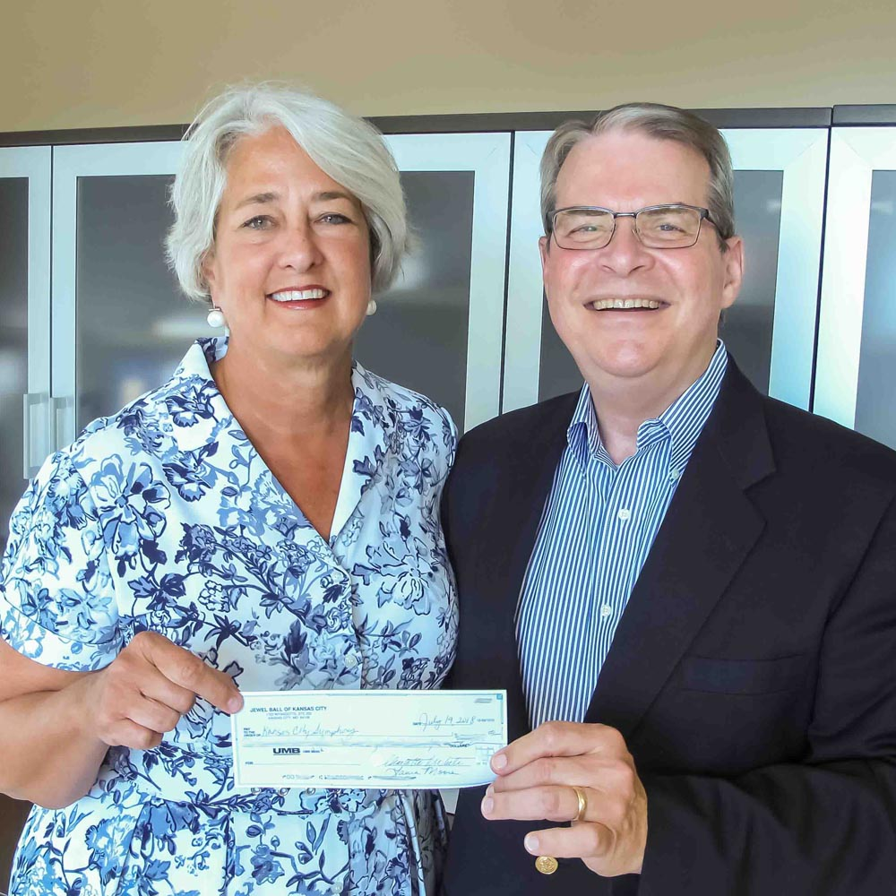 kc symphony donors holding check