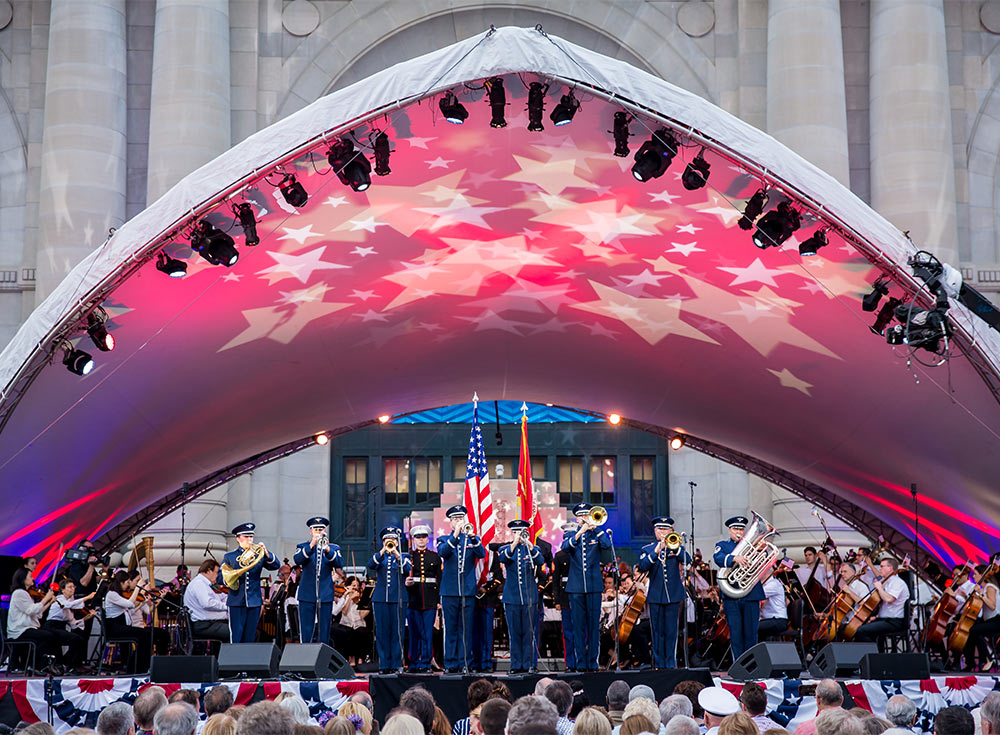 Photo of Armed Salute with the Kansas City Symphony on an outdoor stage in front of Union Station in Kansas City at Bank of America Celebration at the Station