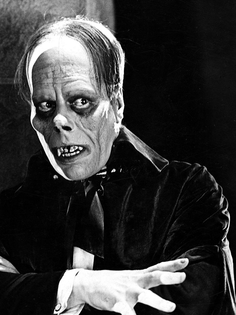 Black and White photo of Lon Chaney as The Phantom of the Opera in the original 1929 silent film