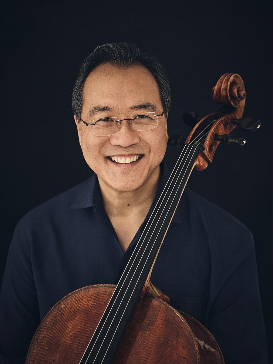 Photo of Yo-Yo Ma smiling while holding his cello