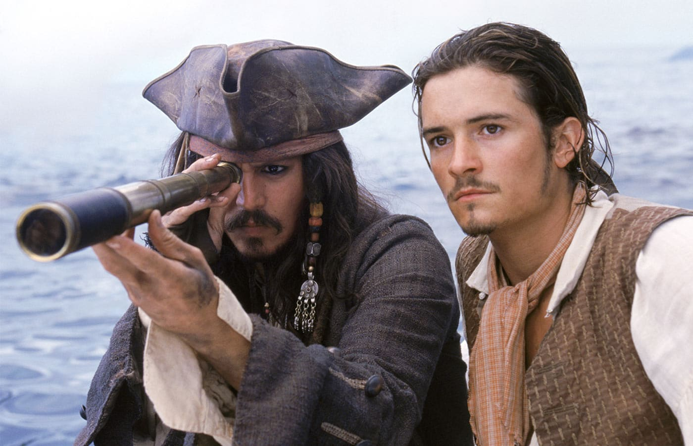 Photo of Johnny Depp and Orlando Bloom on set in the moviePirates of the Caribbean