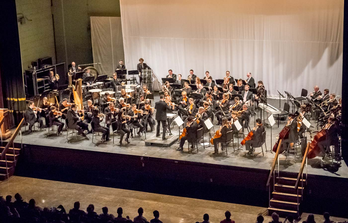 Photo of the Kansas City Symphony with Jason Seber conducting at a Support School Music Community event