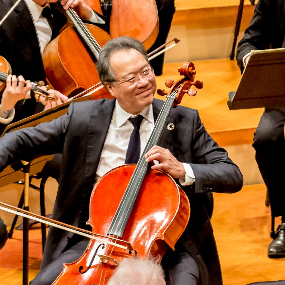 Cellist Yo-Yo Ma smiles while performing with the Kansas City Symphony