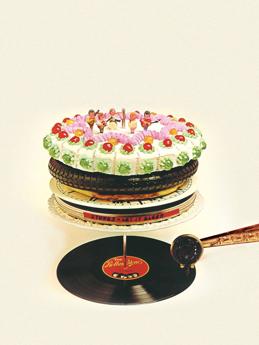 Photo of a cake with a turntable component and an LP