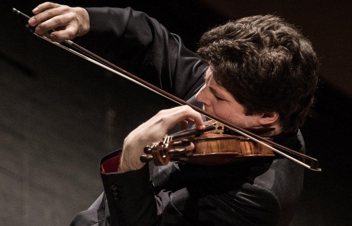 Photo of Augustin Hadelich playing the violin