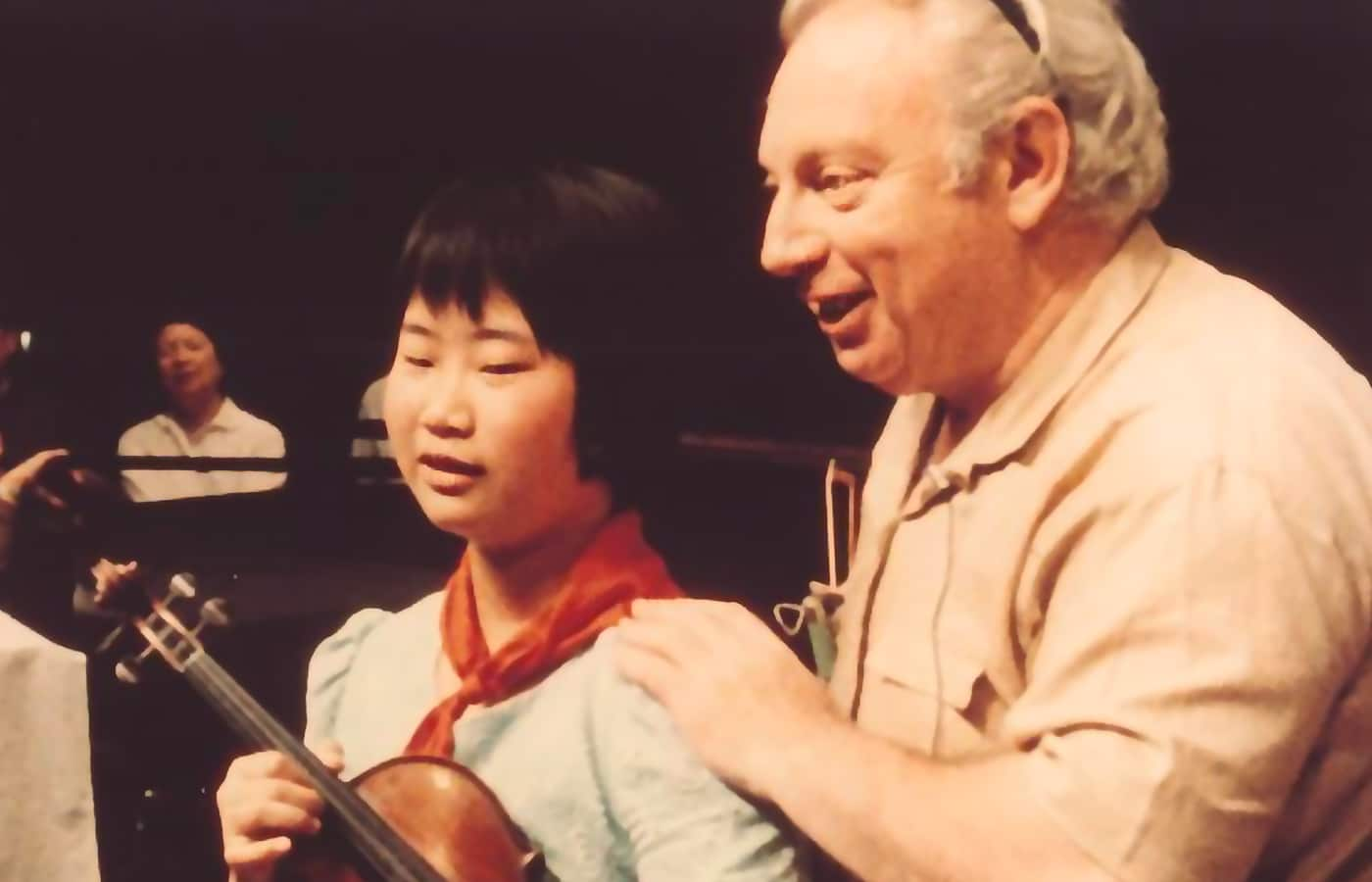 Film still of Isaac Stern with a student in the documentary From Mao to Mozart — Isaac Stern in China