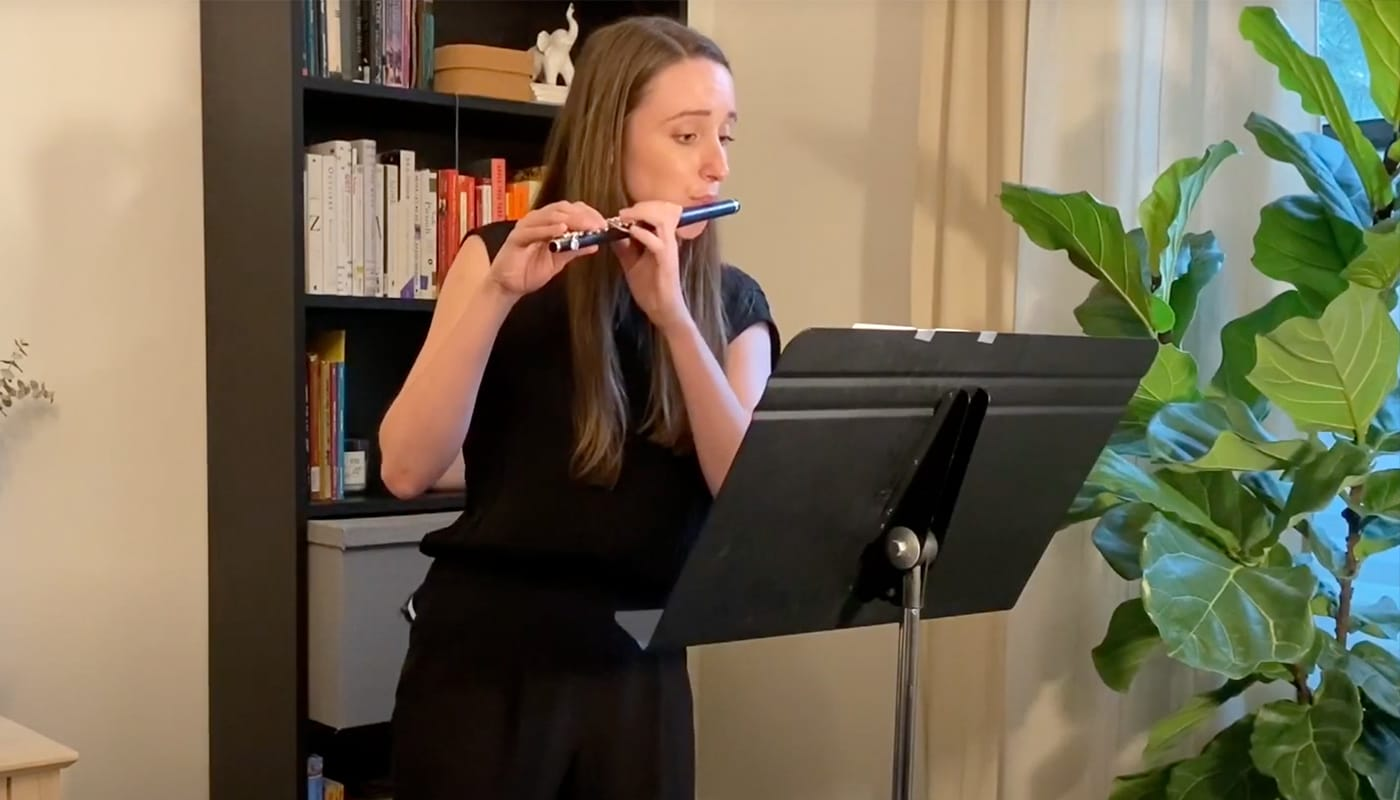Kayla Burggraf performs on the piccolo at a Streaming Saturday performance